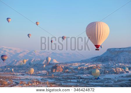 Colorful Hot Air Balloons Flying Over The Famous Tourist Place Cappadocia