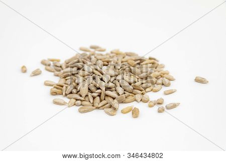 Peeled Sunflower Seeds On A White Background