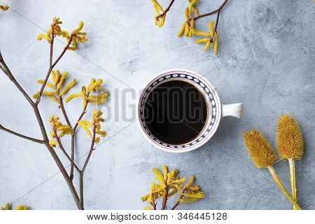 Yellow Flowers Kangaroo Legs On Marbled Background And White Coffee Cup
