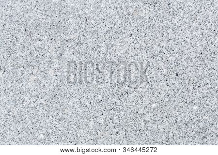 Seamless Mottled Gray And Beige Granite Texture With Dark Blue Splashes. Stone Surface Pattern Backg