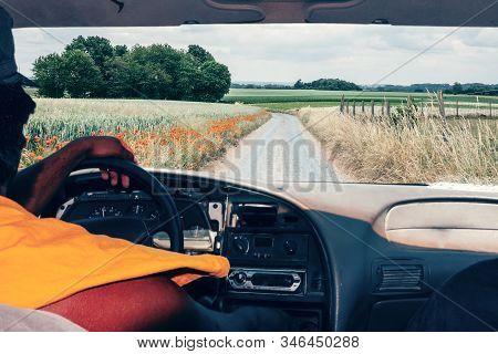 Picture From The Inside Of The Car Of A Man Riding Off-road An Old Fashioned Car - View Of The Dirt