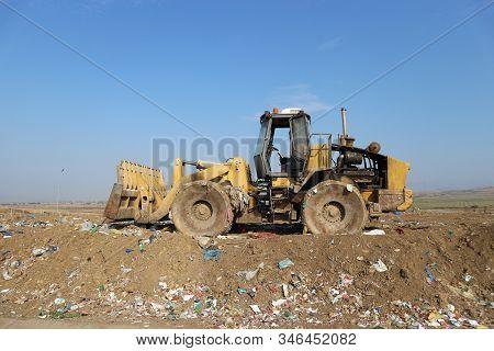Bulldozer Landfill Compactor In A Sanitary Landfill