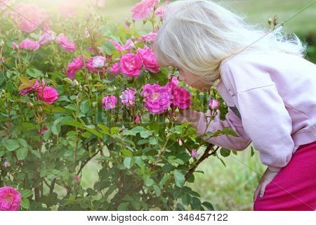little girl outdoors summertime with flowers