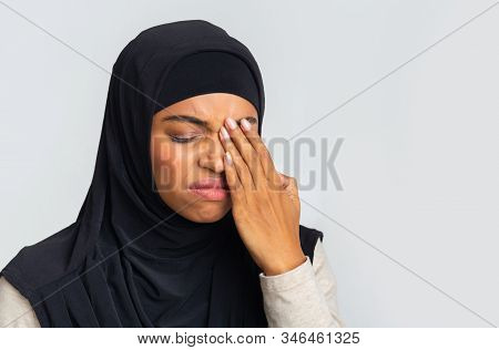 Astigmatism. Black Muslim Girl In Hijab Suffering From Eye Pain, Touching Her Eyelid, Feeling Fatigu