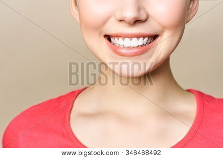 Perfect Healthy Teeth Smile Of A Young Woman. Teeth Whitening. Dental Clinic Patient. Image Symboliz