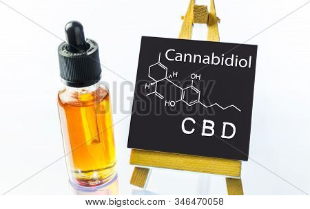 Glass Bottle With Cbd Oils On Shiny White Background With Blackboard And Cbd Molecular Structure Dra