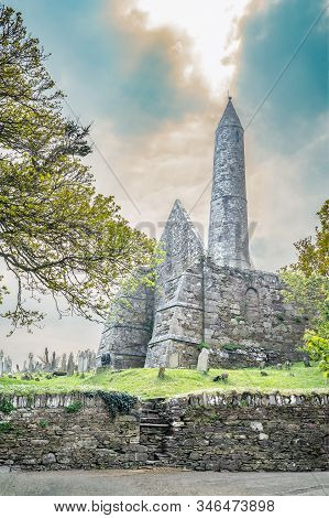 Round Tower And Cemetery In Ardmore Village. South West Of Ireland.