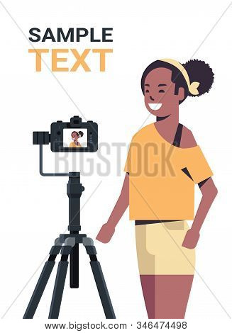 African American Woman Blogger Recording Video Blog With Digital Camera On Tripod Live Streaming Soc