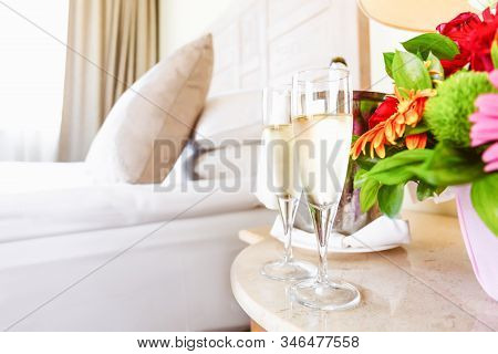 Two Glasses Of Champagne In The Upscale Hotel Room. Dating, Romance, Honeymoon, Valentine, Getaway C