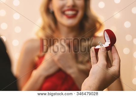 Proposal Concept. Unrecognizable Man Giving Box With Engagement Ring To His Surprised Girlfriend, Pr