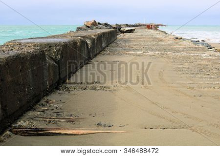 Dilapidated Pier Destroyed By The Fierce Storms Taken On A Forgotten Landscape In Eureka, Ca