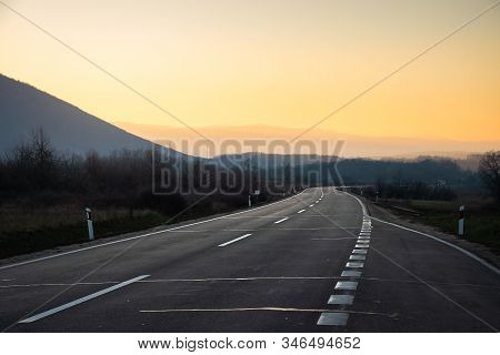 Traveling On Road In Sunset. Traveling By Car On The Road. Highway Landscape In Sunset. Travel By Ca