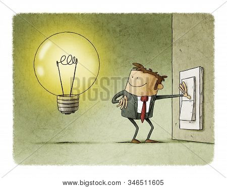 Businessman Presses A Switch And Turns On A Light Bulb Symbol Of Having An Idea.