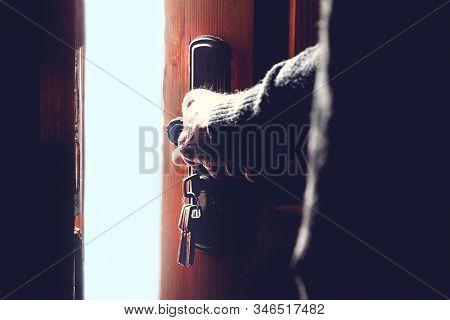 Silhouette Of An Elderly Man Opening The Door