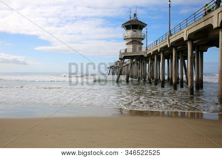 Huntington Beach Pier. Huntington Beach California aka Surf City with the Ocean, Waves, Beach and the World Famous Pier.