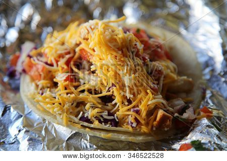 Chicken Tacos. Fresh made Chicken Tacos. Tortilla with Shredded Chicken and Vegetables  hot from the kitchen. People world wide eat chicken tacos for lunch and dinner or even snacks.