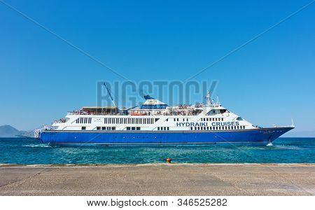 Aegina, Greece  - September 14, 2019: Ferryboat at the port of Aegina. Ship: Hydraki Cruises,