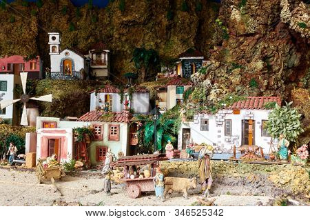 Candelaria, Tenerife, Spain - December 12, 2019: Christmas Belen -  Creche (crib), Nativity Scene, statuette of people and houses in miniature