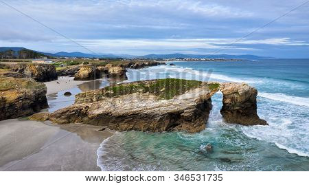 Aerial View Of Natural Stone Arch On Playa De Las Catedrales (beach Of The Cathedrals), Galicia, Spa