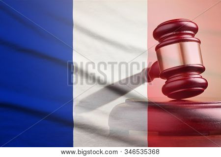 Lawyers Wooden Gavel Over The Flag Of France