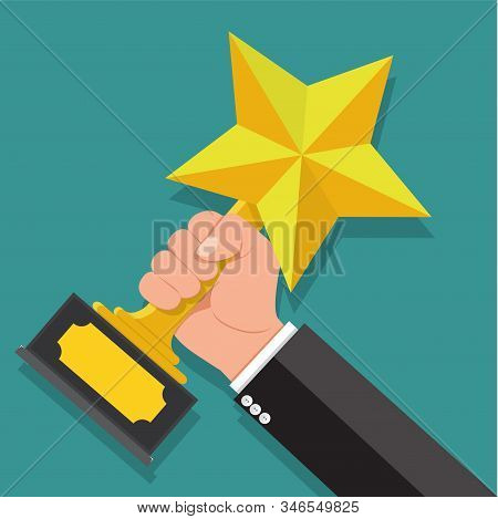 Businessman Hand Holding Star Award. Winner Trophy Award. First Place. Gold Star Award.he Was Awarde