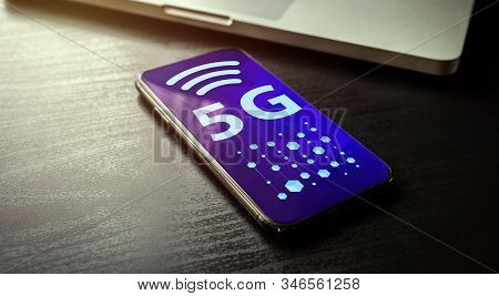 5g Network Technology - High Speed Wireless Systems Concept With Smartphone And Laptop On The Backgr