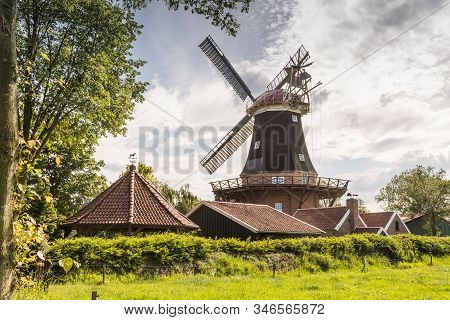 Windmill Rhaude In Green Nature In The County Of Leer, East Frisia, Lower Saxony, Germany