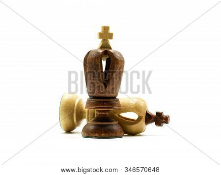 Defeated White King Chess Piece Lying Behind A Standing Black King, Isolated On White Background