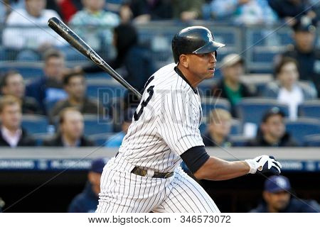 BRONX, NY - MAY 10: New York Yankees third baseman Alex Rodriguez (13) singles to right against the Tampa Bay Rays during the first inning on May 10, 2012 at Yankee Stadium.