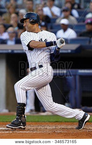 BRONX, NY - SEP 15: New York Yankees shortstop Derek Jeter hits an rbi single against the Tampa Bay Rays on September 15, 2012 at Yankee Stadium.
