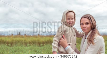 Woman Mother Child, Little Son Boy 4-5 Years Old, Autumn Park, Hugging, Emotions Of Happiness, Pleas