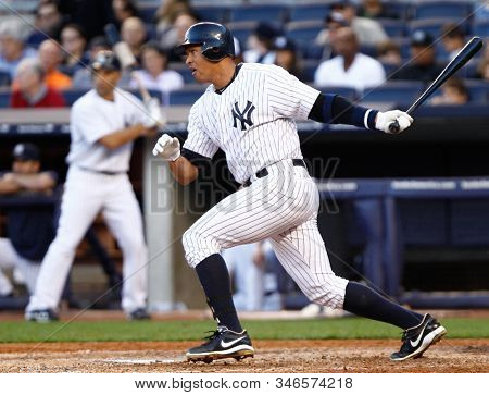 BRONX, NY - SEP 15: New York Yankees third baseman Alex Rodriguez (13) singles to center against the Tampa Bay Rays on September 15, 2012 at Yankee Stadium.