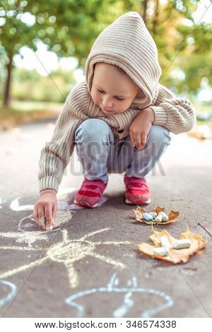 Little Boy 3-5 Years Old, Happy Draws Colorful Crayons On Pavement, Creativity In Park, Feel Happy.