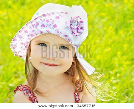 Little Girl On The Meadow In Summer Day