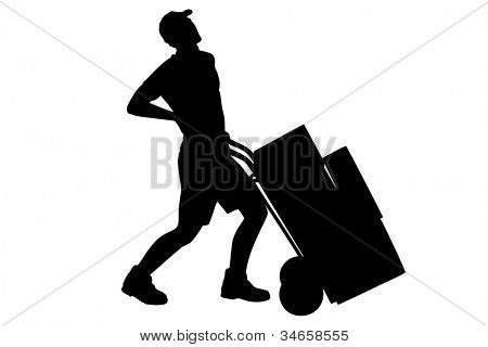 A silhouette of a full length portrait of a delivery boy, suffering from a back pain, pushing a hand truck isolated on white background