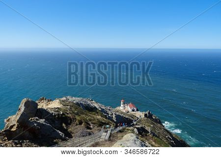 A Steep Staircase Leads Past The Rocky Terrain Down To The Point Reyes Lighthouse Overlooking The Pa