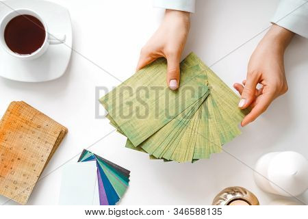 Metaphorical Associative Cards. Consultation Of A Psychologist. Young Woman Holds A Deck In Hands An