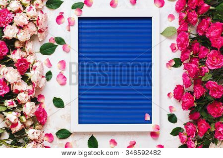 Beautiful  Pink And Red Roses Directed At Each Other On Rustic White Surface And Empty White Wooden