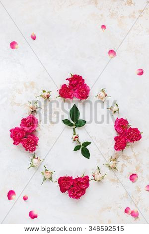 Various Brightly Colored Pink And Red Roses And Buds Making The Shape Of A Clock. Top View, Blank Sp