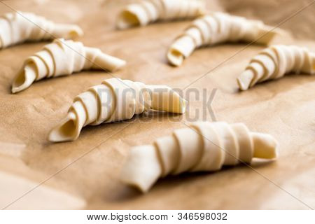 Producing Classic Small Croissants At Home Or Cafe. French Pastry Goods. Family Cooking Concept. Pre