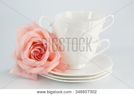 White Porcelain Cup With A Saucer For Tea Or Coffee And Pink Rose, Demitasse Or Teacup. Crockery On