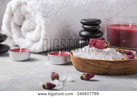 Spa Concept: Composition Of Spa Treatment With Spa Stone. Beauty Still Life Of Massage Oil Bottle Of