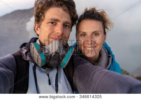 Selfie Photo Of Adventure Seekers With  Beautiful Mountain  Landscape And Blue Lake With Smoke  In A