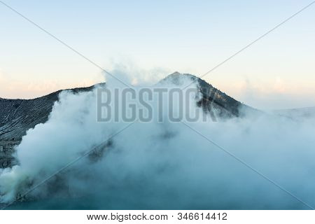 Beautiful Landscape Mountain And Blue Lake With Smoke Sulfur In The Morning In A Kawah Ijen Volcano.
