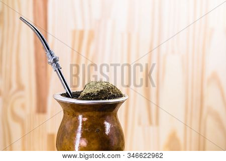 Traditional Argentinian, Brazilian And Uruguayan Yerba Tea In A Gourd Gourd With Bombilla Stick Agai