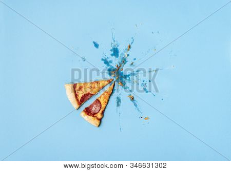 Lat Two Pizza Pepperoni Slices And Grease Traces, Crumbs On Blue Background. Pizza Salami Leftovers