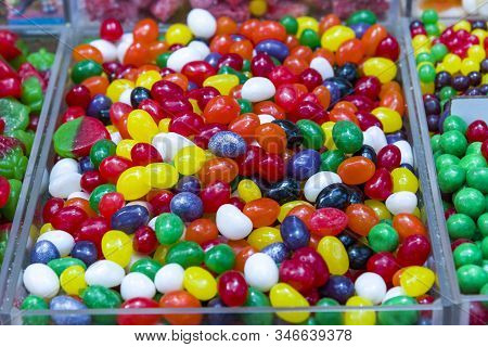 Different Fruit Candies. Colorful Bright Chewy Candies Covered With Sugar. Rainbow Ribbon Candies. C