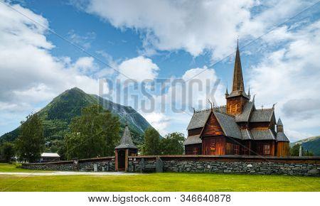 Old wooden Lom stave Church (Lom Stavkyrkje), Fossbergom, Sogn og Fjordane county, Norway. Landscape photography