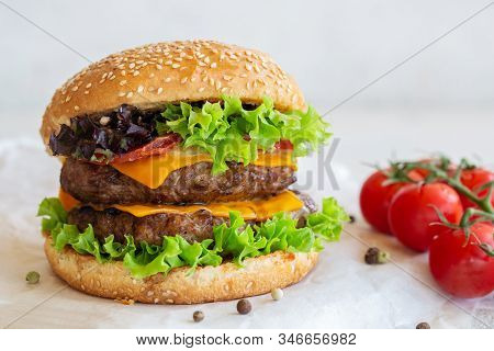 Large Cheeseburger With Two Beef Patties Grilled On The Table.