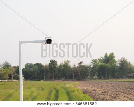 Outdoor Cctv Camera Operating Inside Organic Farm Plantation.